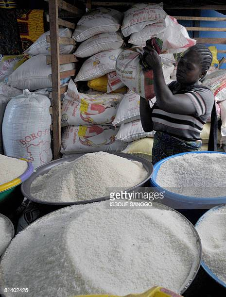 A woman carries a bag of rice on June 4 2008 at the Abobo market in Abidjan on the second day of the the UN Food and Agriculture summit on food...