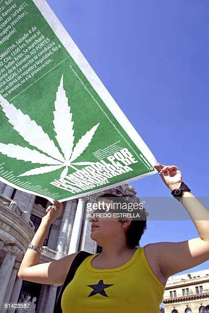 A woman carries a banner in support of the International Day for the Liberation of Marijuana in Mexico City 04 May 2002 AFP PHOTO/Alfredo ESTRELLA...