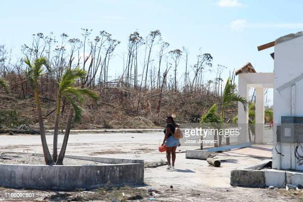 A woman carries a gas container after Hurricane Dorian passed through in The Mudd area of Marsh Harbour on September 5 2019 in Great Abaco Island...