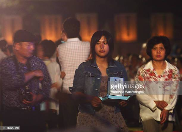 A woman carries a lantern and attends celebrations for the Obon Festival honouring the spirits of deceased ancestors at Eiheiji on August 21 2011 in...