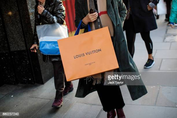 A woman carries a Louis Vuitton bag down Brompton Road on November 24 2017 in London England The American actress Meghan Markle will live at...
