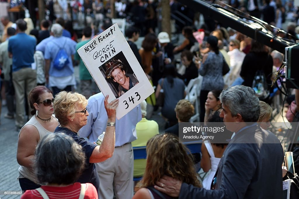 A woman carries a photo of o 9/11 attacks victim on the 15th anniversary of the 9/11 in Ground Zero, Manhattan, New York, United States on September 11, 2016.