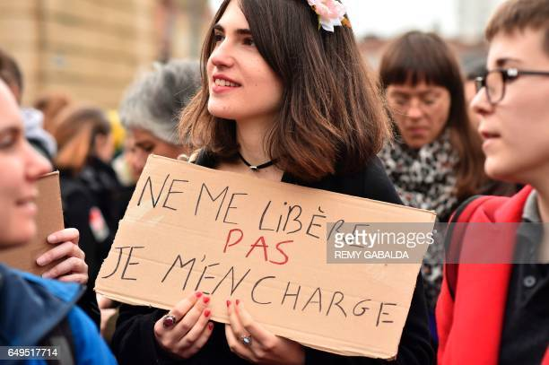 A woman carries a placard reading 'Do not free me I am in charge' during a demonstration march on March 8 2017 in Toulouse as part of International...