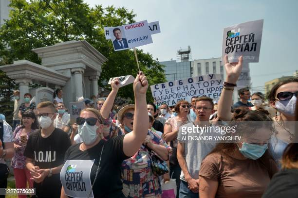 A woman carries a placard reading Freedom for Furgal during an unauthorised rally in support of Sergei Furgal the governor of the Khabarovsk region...