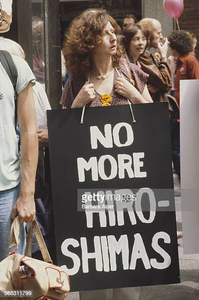 A woman carries a placard reading 'No More Hiroshima's' at an antinuclear demonstration New York City USA 12th June 1982