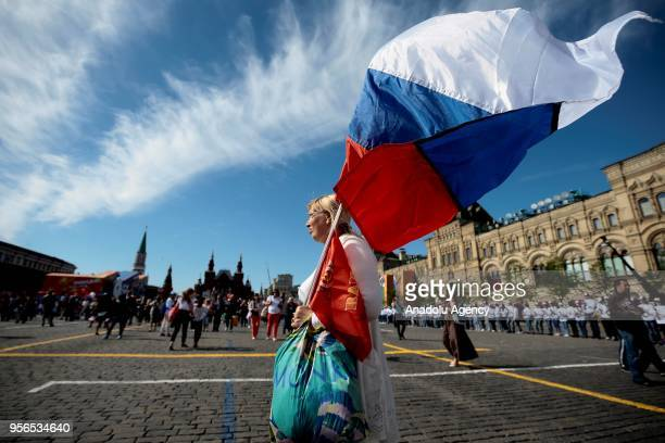 A woman carries a Russian flag during an Immortal Regiment march on the day of the 73rd anniversary of the Victory over Nazi Germany in the 194145...