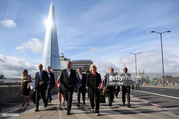 A woman carries a Union Flag as she walks with other commuters across London Bridge after it was reopened following the June 3rd terror attack on...