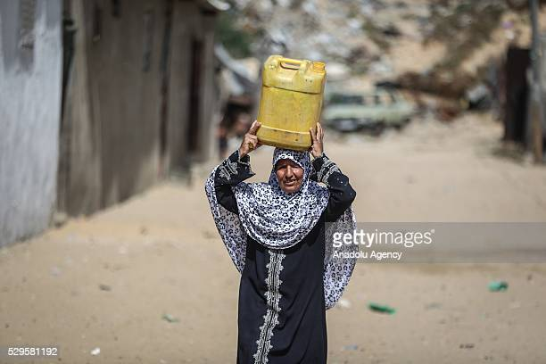 Woman carries a water bucket as Palestinians face a water crisis in Gaza City, Gaza on May 9, 2016. Palestinians use most of the Gaza's main water...