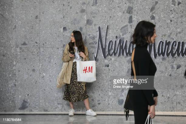 A woman carries an HM bag inside 'The Shops' during the grand opening of phase one of the Hudson Yards development on the West Side of Midtown...