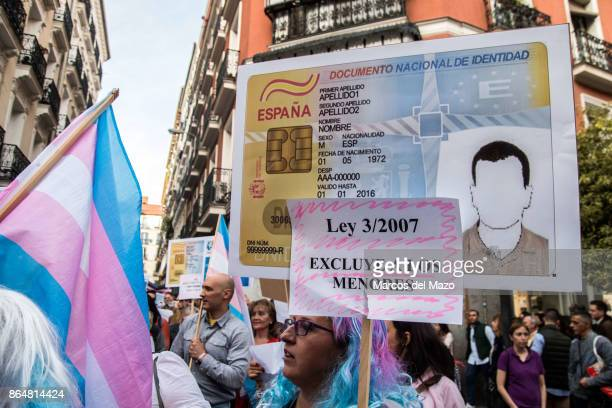 A woman carries an unfilled identity card during a transgender demonstration under the slogan Our bodies are weapons of battle