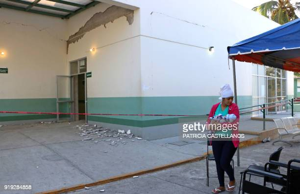 TOPSHOT A woman carries her newborn son outside the hospital seriously damaged by the 72 magnitude earthquake in Santiago Jamiltepec Oaxaca state...