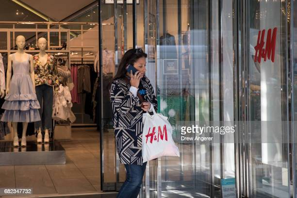 A woman carries her shopping bag as she exits an HM store May 12 2017 in the Herald Square neighborhood in New York City The US Commerce Department...