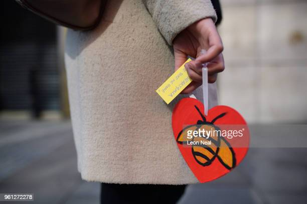 A woman carries one of the 27000 handmade hearts that have been donated to Beth Clarke's #aheart4mcr Twitter campaign on the morning of the first...