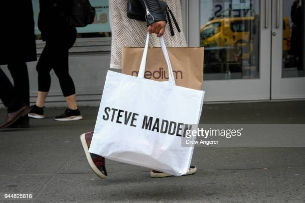 A woman carries shopping bags in the Herald Square neighborhood of Manhattan April 11 2018 in New York City US consumer prices rose 24 percent in...