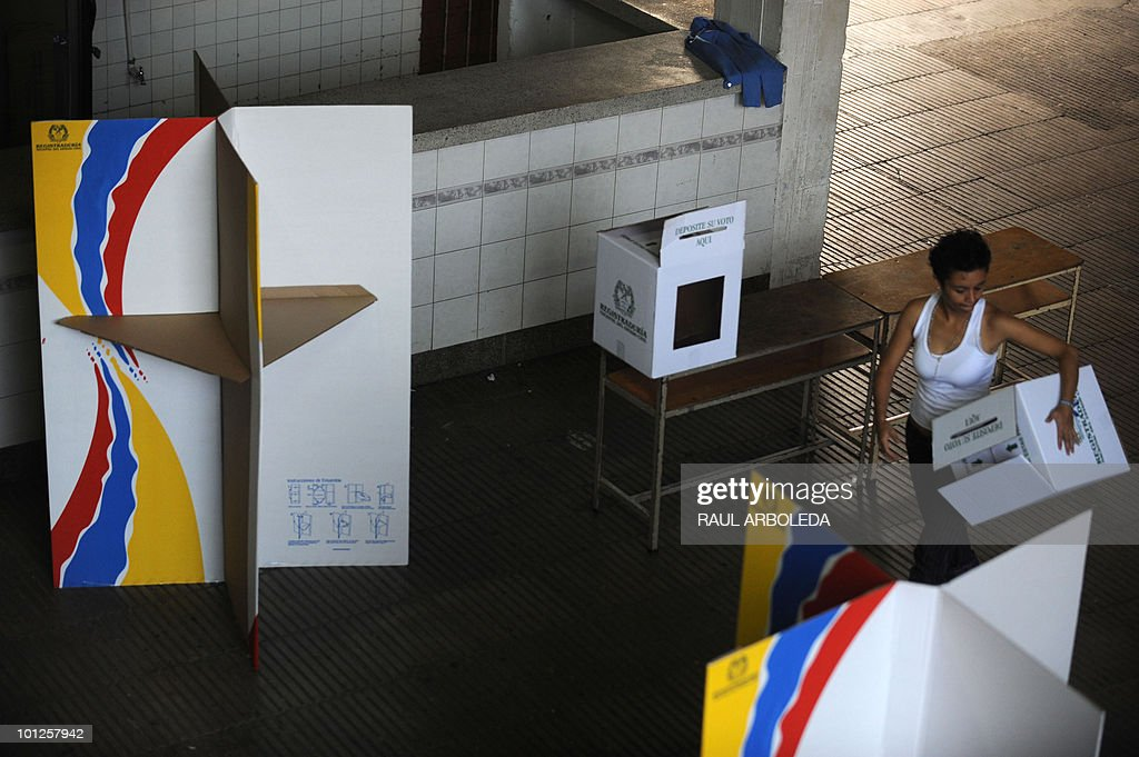 A woman carries voting booths at a polling center in Medelllin, Antioquia department, Colombia on May 29, 2010. Colombia will hold presidential elections next May 30, and according to polls, a run-off election between Antanas Mockus for the Green Party and Juan Manuel Santos for the ruling National Unity Party, will take place on June 20. AFP PHOTO/ Raul ARBOLEDA
