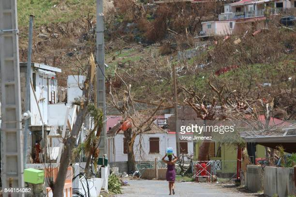 A woman carries water in Grand Case Saint Martin days after this Caribbean island sustained extensive damage after the passing of Hurricane Irma on...
