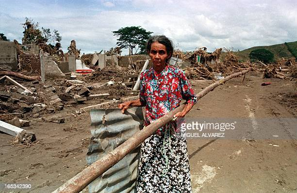 A woman carries wood and tin roofing to build a home 08 November in Wiwili Nicaragua The town 225 kilometers north of Managua one of the hardest hit...