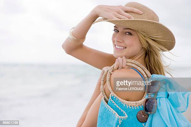 Woman carrying a bag on the beach