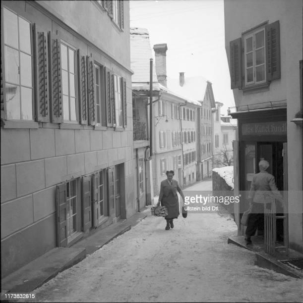 Woman carrying a bundle of fire wood Schwyz 1950 1950