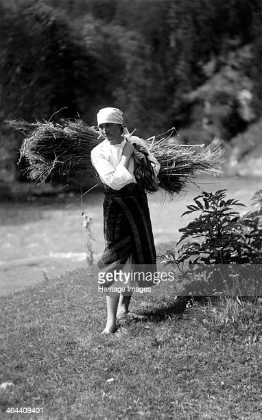 Woman carrying a bundle of sticks Bistrita Valley Moldavia northeast Romania c1920c1945 Depicting customs and traditional labour in the rural...