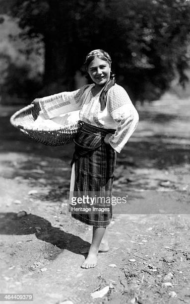Woman carrying a large basket Bistrita Valley Moldavia northeast Romania c1920c1945 Depicting customs and traditional labour in the rural Carpathian...