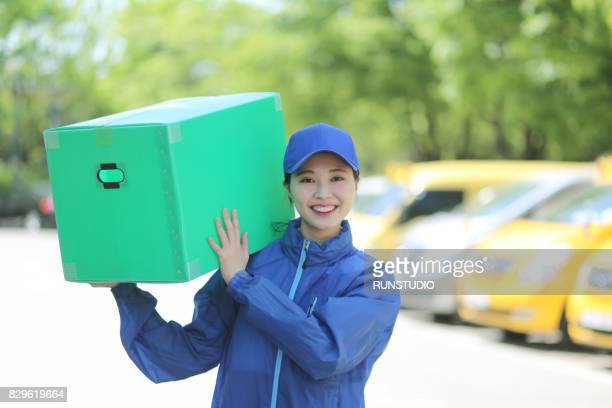 woman carrying a moving box