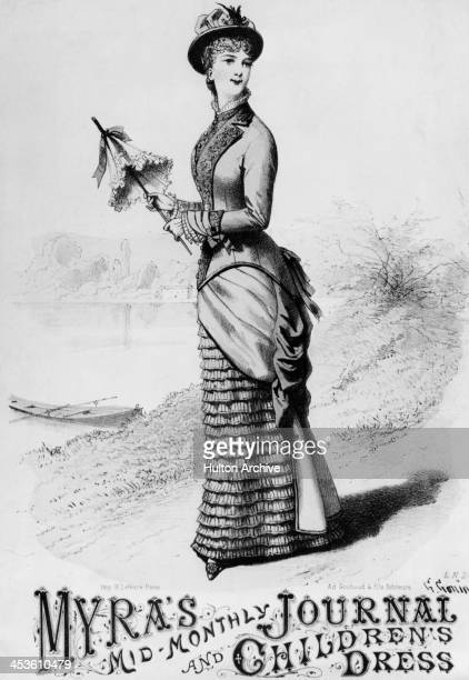 A woman carrying a parasol modeling a dress on the waterfront 15th June 1879 Original publication Myra's MidMonthly Journal and Children's Dress