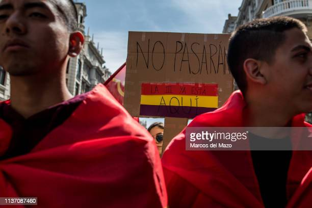 Woman carrying a placard that reads 'they will not pass. The Republic is here' protesting against the monarchy during a demonstration on the...