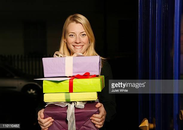 Woman Carrying a Stack of Wrapped Presents