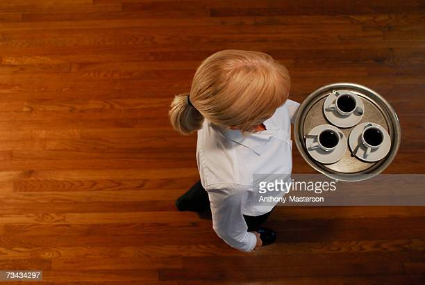 woman carrying a tray of coffee cups, overhead view - anthony-masterson stock pictures, royalty-free photos & images