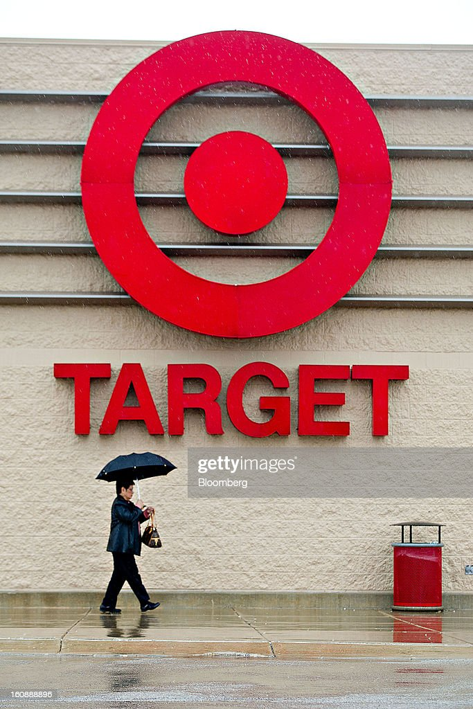 A woman carrying an umbrella walks outside a Target Corp. store in Peru, Illinois, U.S., on Thursday, Feb. 7, 2013. Target Corp. led U.S. retailers to the biggest monthly same-store sales gain in more than a year as shoppers snapped up discounted merchandise chains were clearing out after the holidays. Photographer: Daniel Acker/Bloomberg via Getty Images