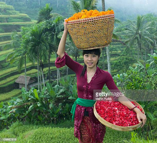 woman carrying basket of flowers