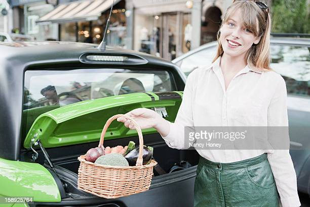 woman carrying basket of vegetables - nancy green stock pictures, royalty-free photos & images