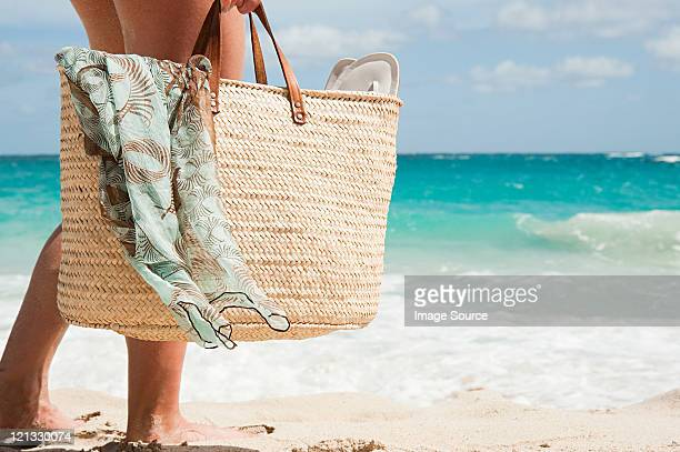 woman carrying beach bag, mustique, grenadine islands - woman carrying tote bag stock photos and pictures