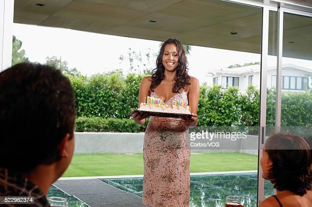 Woman Carrying Birthday Cake
