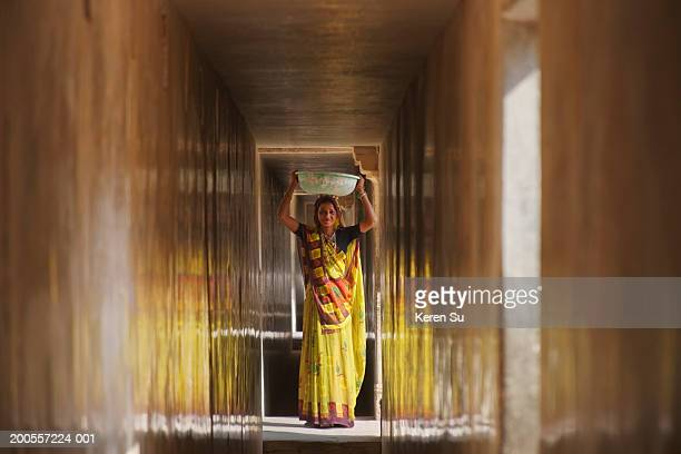 Woman carrying bowl in Amber Palace