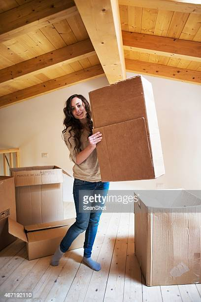 Woman Carrying Boxes During a Moving
