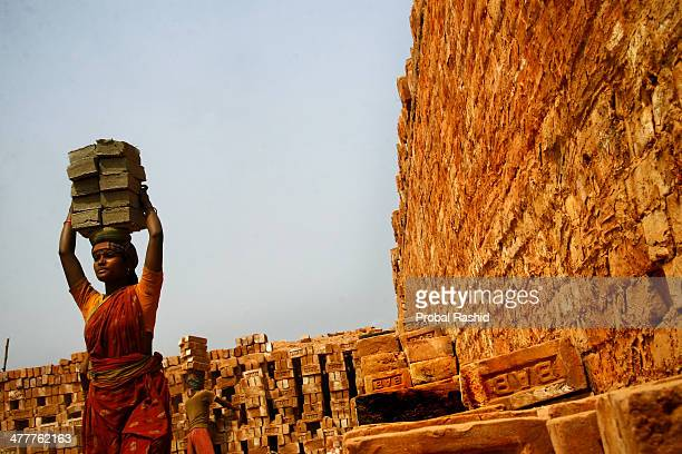 GAZIPUR DHAKA BANGLADESH DHAKA BANGLADESH A woman carrying bricks in a brick field at Gazipur Thousands of women from the northern part of the...