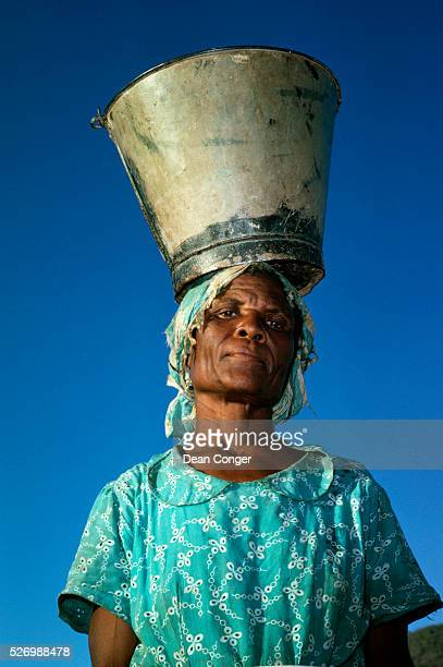 Woman Carrying Bucket on Her Head