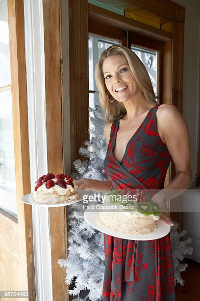 woman carrying cakes at christmas