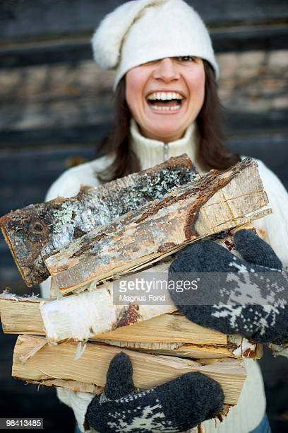 A woman carrying firewood Dalarna Sweden.