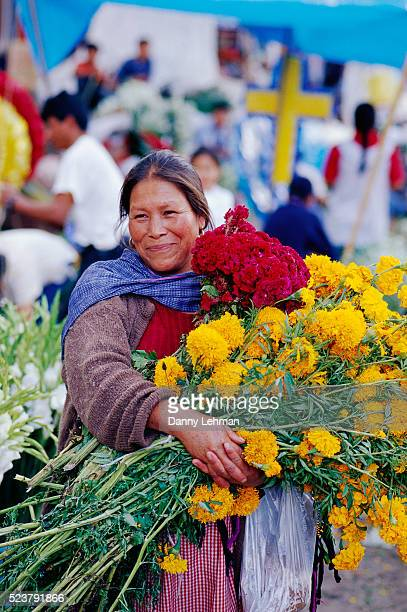 Woman Carrying Flowers for Day of the Dead