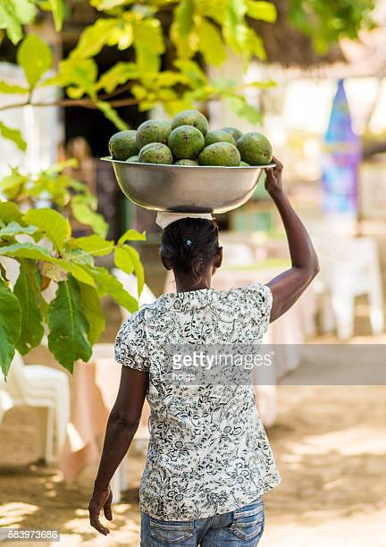 Woman carrying fruits