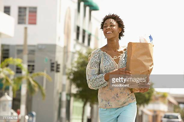 Woman Carrying Groceries Home