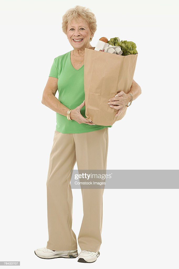 Woman carrying groceries : Stockfoto