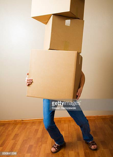 Woman Carrying Heavy Boxes