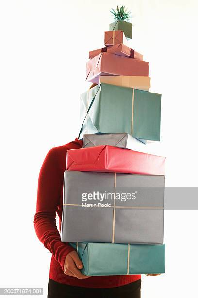 Woman carrying large stack of gifts