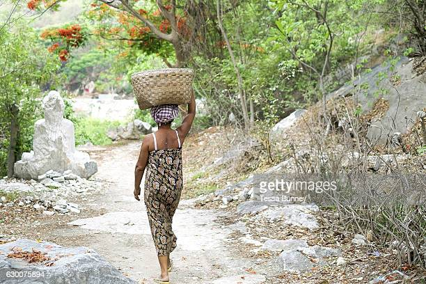 A woman carrying marble waste in Sagyin village on 19th May 2016 in Mandalay division Myanmar Sagyin a village 21 miles north of Mandalay is known...