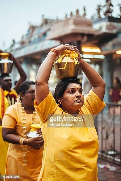 Woman carrying 'Paal Kudam' as part of Thaipusam ritual in Batu Caves, Kuala Lumpur, Malaysia