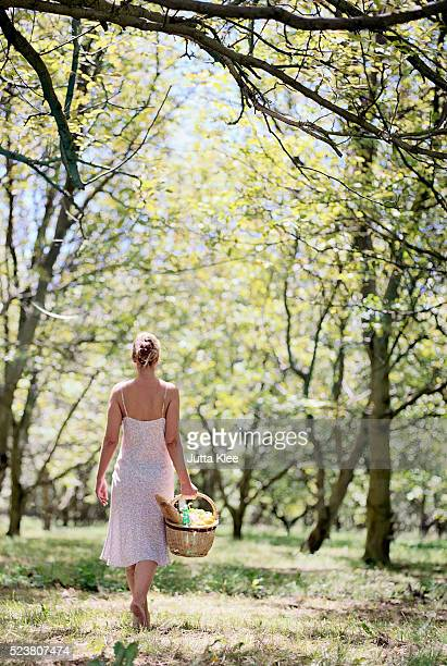 Woman Carrying Picnic Basket